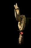 Ainda vida, mão da Buda e flor isoladas no preto, a arte fotos de stock royalty free