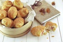 Ainda vida retro com croissant e o diário frescos Fotografia de Stock Royalty Free