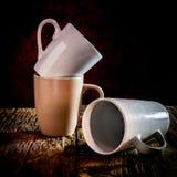 Ainda vida três copos empilhados na madeira Fotos de Stock Royalty Free