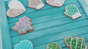 Ainted gingerbread. Homemade cookies for Christmas. Treats for the New Year or Christmas table. Christmas treats. Christmas gingerbread cookies with ornaments stock footage