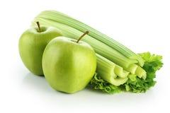 Aipo com a maçã verde isolada no fundo branco Fotos de Stock Royalty Free