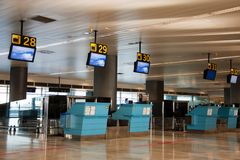 Aiport check-in counters. Several baggage checking at airport Stock Image