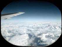 In the air. Airplane view on mountains (Alps Royalty Free Stock Images