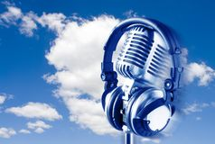 On The Air!!. Flying Retro Microphone & Headphones Over Blue Sky Stock Image