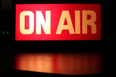 On-Air. Studio sign glowing in center with red reflection and copy space royalty free stock photo