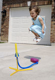 AIR. A young girl jumping on her toy Royalty Free Stock Photography