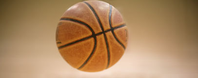 In the Air. Real shot of a basketball in the air with clean vignette background Stock Images