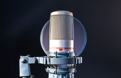 On Air. A microphone with a pop or spit filter Stock Photography