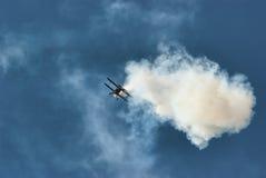 Air acrobatics. Airplane acrobatics on the sky Stock Images