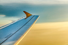 By Air. Airplane Wing in Flight from window Stock Photo