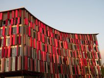 Air Albania Stadium with Red and Brown Metal Exterior in Golden Light