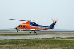 Air Ambulance. Helicopter leaving for a life saving mission Stock Images