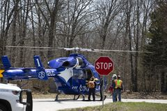 Air ambulance helicopter with emergency personnel  Stock Photos
