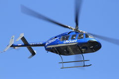 Air ambulance after lift off. Air ambulance helicopter in air just after lift off stock photo