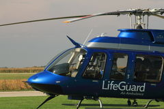 Air ambulance pilot prepares for take off. An air ambulance pilot preparing for lift off stock image