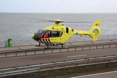 Air ambulance taking off from highway royalty free stock image