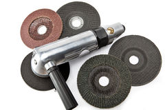Air angle grinder and different grinding wheels on white background Royalty Free Stock Image
