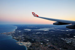 Air Asia X logo on it wing, flying over Perth Royalty Free Stock Images
