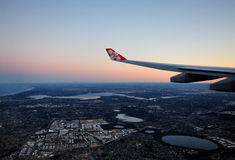 Air Asia X logo on it wing, flying over Perth Royalty Free Stock Image