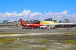 Air- Asiaflugzeuge an internationalem Flughafen Manilas Lizenzfreie Stockbilder