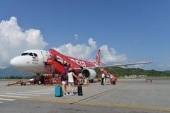 Air- Asiajet-Flug Lizenzfreie Stockbilder