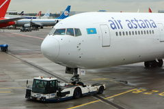 Air Astana 767 pushing back from gate stock photography