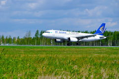 Air Astana Airbus A320 aircraft is riding on the runway after arrival at Pulkovo International airport in Saint-Petersburg, Russia Royalty Free Stock Photo