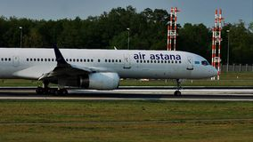 Air Astana plane on runway in Frankfurt Airport, FRA. Air Astana airplane in Frankfurt Airport, FRA, Germany. Touchdown runway stock footage