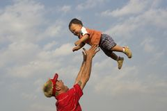 Air Baby. Father playing with his son Stock Image