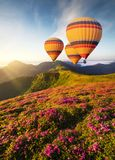 Air ballon above mountains at the summer time. stock photo