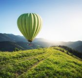 Air ballon above mountains at the summer time. stock photography