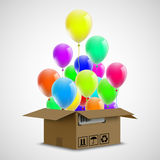 Air ballons in a cardboard box. Cargo delivery. Celebration even Royalty Free Stock Photo