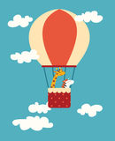 Air balloon animals print. Giraffe and zebra in a balloon in the sky with clouds Stock Photo