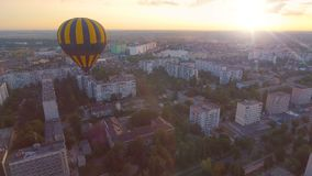 Air balloon flying over city towards rising sun, romantic surprise, anniversary. Stock footage stock video footage