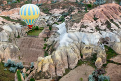 Air balloon flying over rock formation. View of the air balloon flying over rock formation in Cappadocia,Turkey Stock Photography