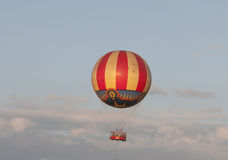 Air balloon. Large red and yellow balloon floating in the sky Royalty Free Stock Image