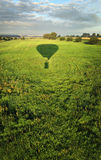 AIR BALLOON SHADOW AT GREEN FIELD FROM THE SKY IN  Stock Images