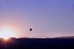 Air Balloon Sunset. A background of a hot air-balloon with a sunset over the mountains in Albuquerque, New Mexico, USA Stock Image