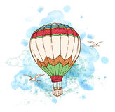 Air balloon and watercolor blots. Blue abstract background with air balloon and watercolor blots. Hand drawn vector illustration Royalty Free Stock Images