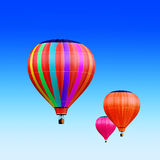 Air-balloons. Soar hot air balloons on blue sky Stock Images