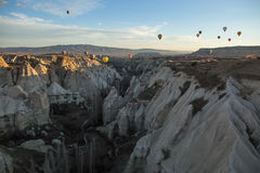Air balloons above the mountains Stock Images