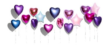 Air balloons. Bunch of purple heart shaped foil balloons, isolated on white background. Valentine`s day royalty free stock photo