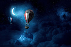 Air balloons in evening sky Royalty Free Stock Photos