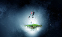 Air balloons in evening sky . Mixed media Royalty Free Stock Images