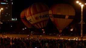 Air balloons glowing in the night stock footage