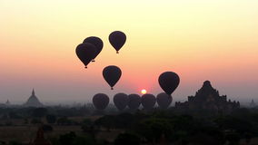 Air Balloons go Up in Sunrise in Bagan 1. Air balloons go up in sunrise in Bagan, Myanmar (Burma). Magic sunrise with air balloons and spectacular colors stock video