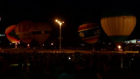 Air balloons in the night stock footage