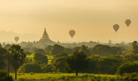 Air balloons over Buddhist temples at sunrise in Bagan Stock Images