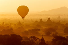 Air balloons over Buddhist temples at sunrise.