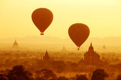 Air balloons over Buddhist temples at sunrise
